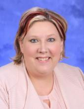 Photo of Kelly Thormodson with a blue background
