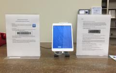 Self-checkout iPad mini at the service desk